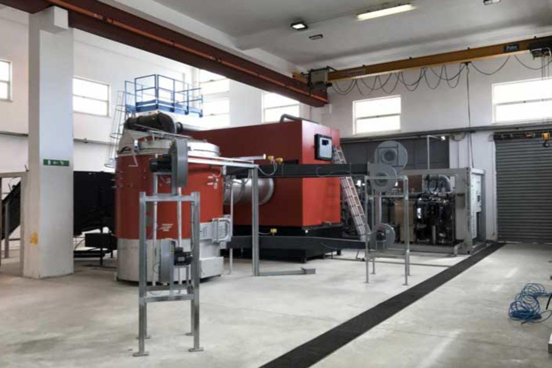 Impianto a biomassa legnosa 200kw: bruciatore e caldaia